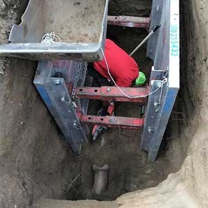Man Digging in a Hole